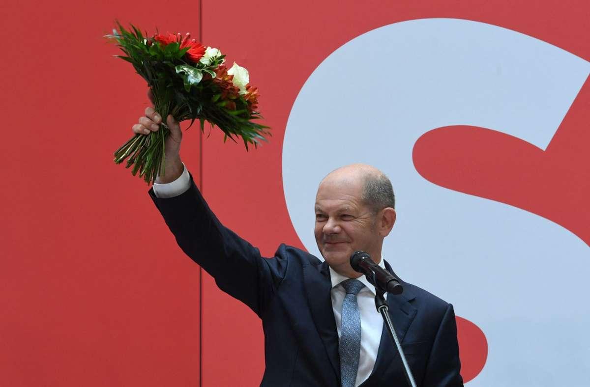 Olaf Scholz und die SPD feiern den Wahlerfolg. Foto: AFP/CHRISTOF STACHE