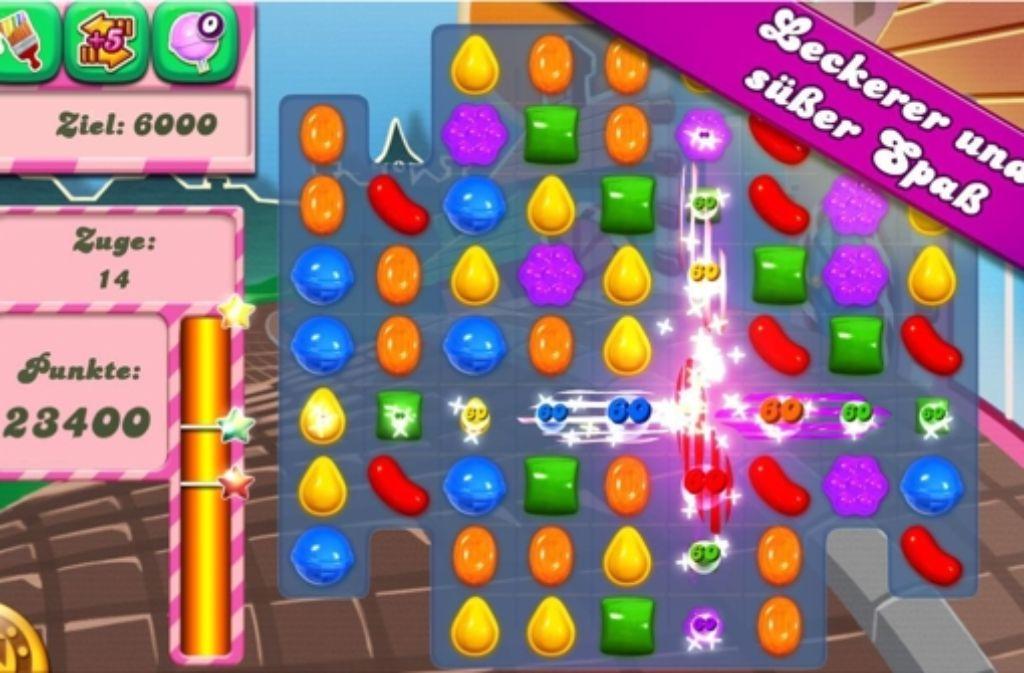 """Drei gewinnt bei dem Spiel """"Candy Crush Saga"""": Gelingt es dem Spieler drei identische Süßigkeiten vertikal oder horizontal anzuordnen, passiert ein kleines Feuerwerk auf dem Bildschirm. Foto: Google Play Store"""