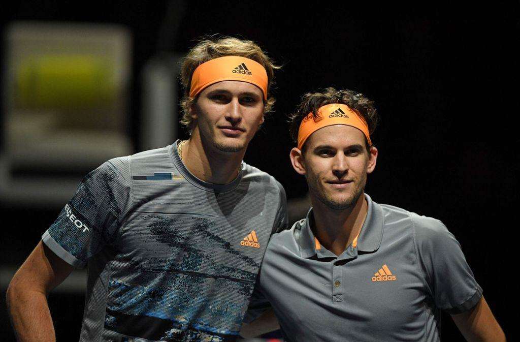 Gleicher Sponsor, unterschiedliches Tennisspiel: Alexander Zverev (links) und sein Kumpel Dominic Thiem. Foto: AFP/Daniel Leal-Olivas