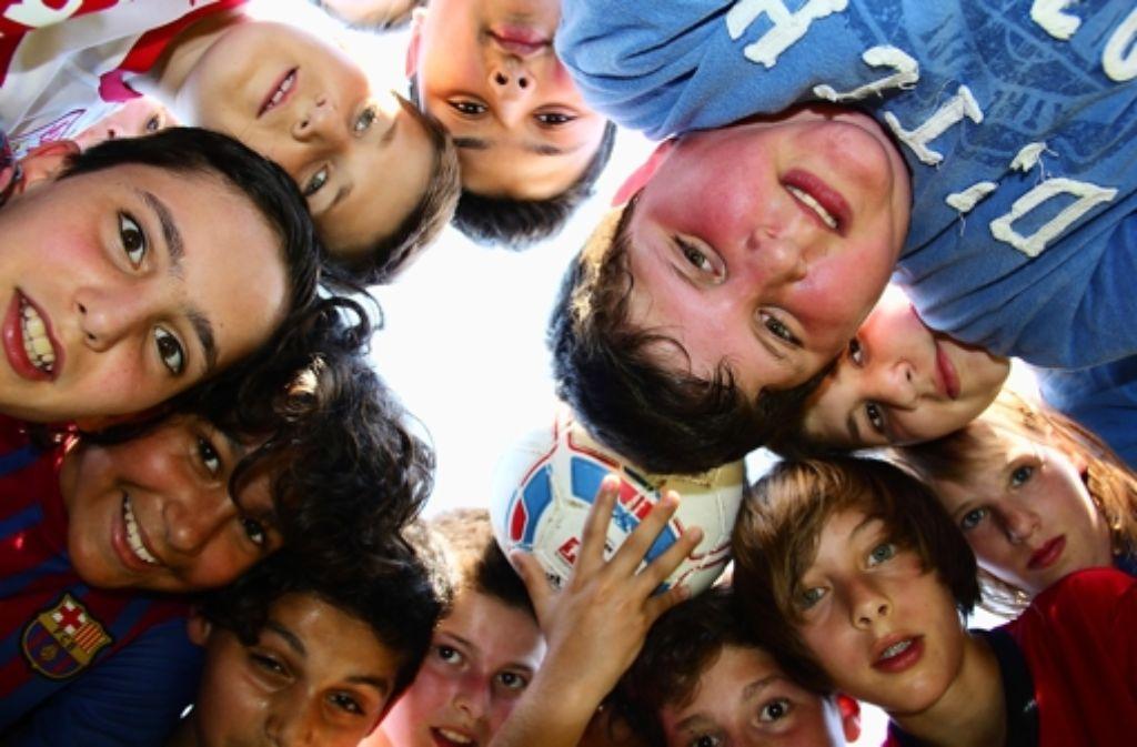 Mit hochroten Köpfen und hoch motiviert: Die Schüler der Realschule Feuerbach profitieren von dem Gemeinschaftserlebnis Foto: Georg Friedel