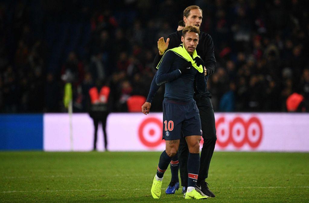 Neymar mit seinem deutschen Trainer Thomas Tuchel. Foto: AFP