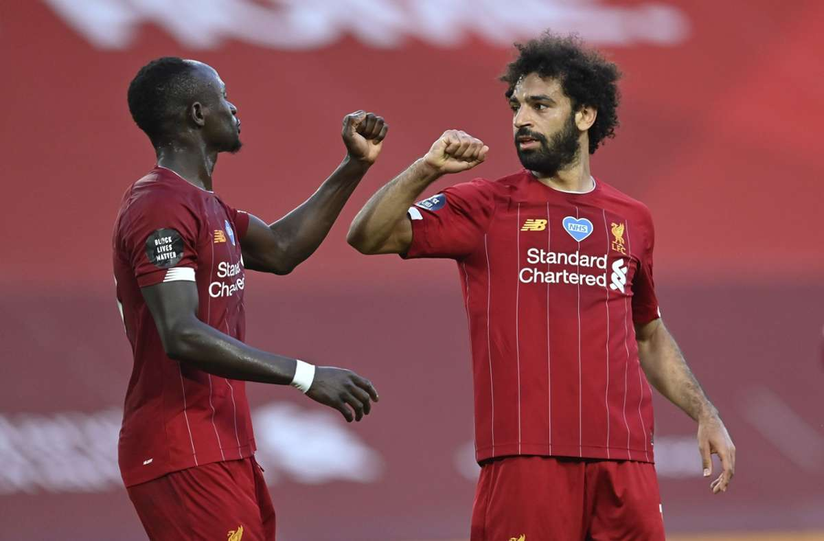 Sadio Mané und Mohamed Salah sind mit dem FC Liverpool Englischer Meister. Foto: dpa/Paul Ellis