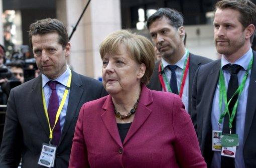 Merkel gibt sich verhalten optimistisch