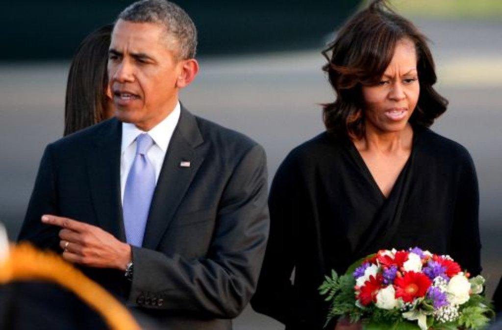 Sie stehen auf der Gästeliste der Trauerfeierlichkeiten für den verstorbenen südafrikanischen Präsidenten Nelson Mandela: US-Präsident Barack Obama und seine Frau Michelle. Foto: dpa