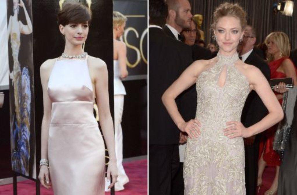 Für einen Mode-Seitensprung bei der Oscar-Verleihung hat sich Schauspielerin Anne Hathaway (30, links) bei Modeschöpfer Valentino entschuldigt. Sie habe erfahren, dass ein ... Foto: dpa