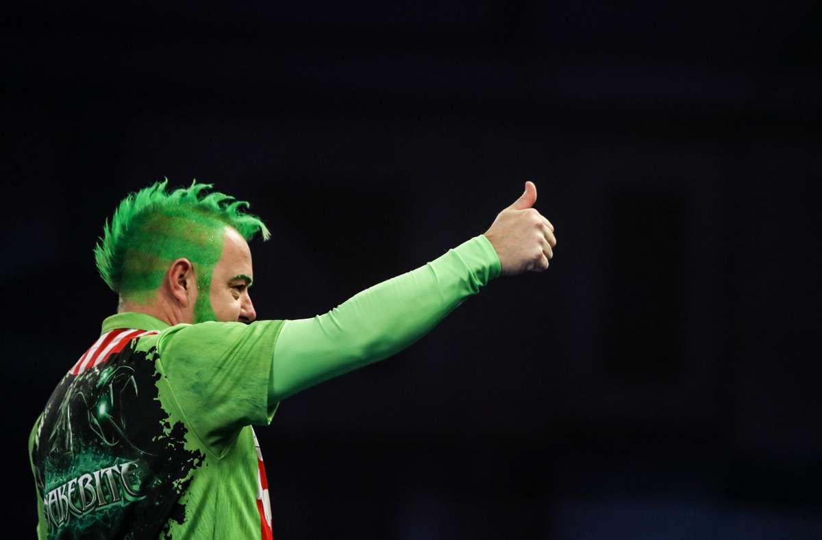 Ob Peter Wright seinen Titel als Weltmeister verteidigt, ist noch offen. Foto: dpa/Kieran Cleeves