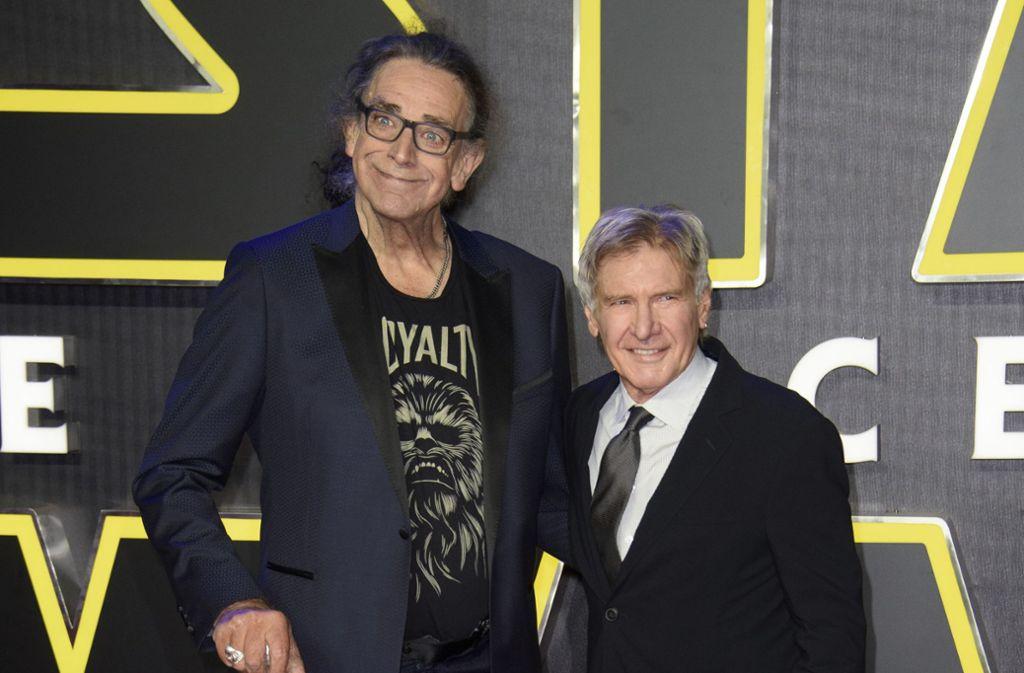 """Es war kein Filmtrick aus """"Star Wars"""": Der Chewbacca-Darsteller Peter Mayhew (li.) war auch im Leben viel größer als Harrison Ford alias Han Solo. Foto: dpa"""