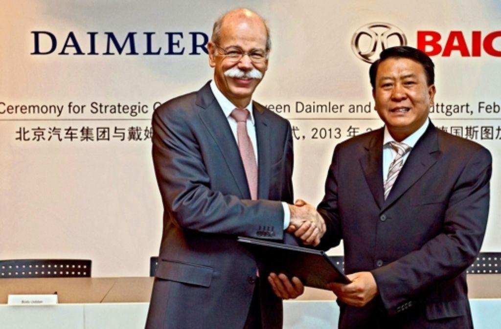 Zetsche (Daimler) und Xu Heyi (BAIC) wollen noch näher zusammenrücken. Foto: Daimler