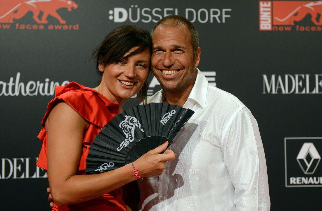 Stil-Ikone und Formel-1-Reporter: Kai Ebel mit seiner Frau Mila. Foto: dpa