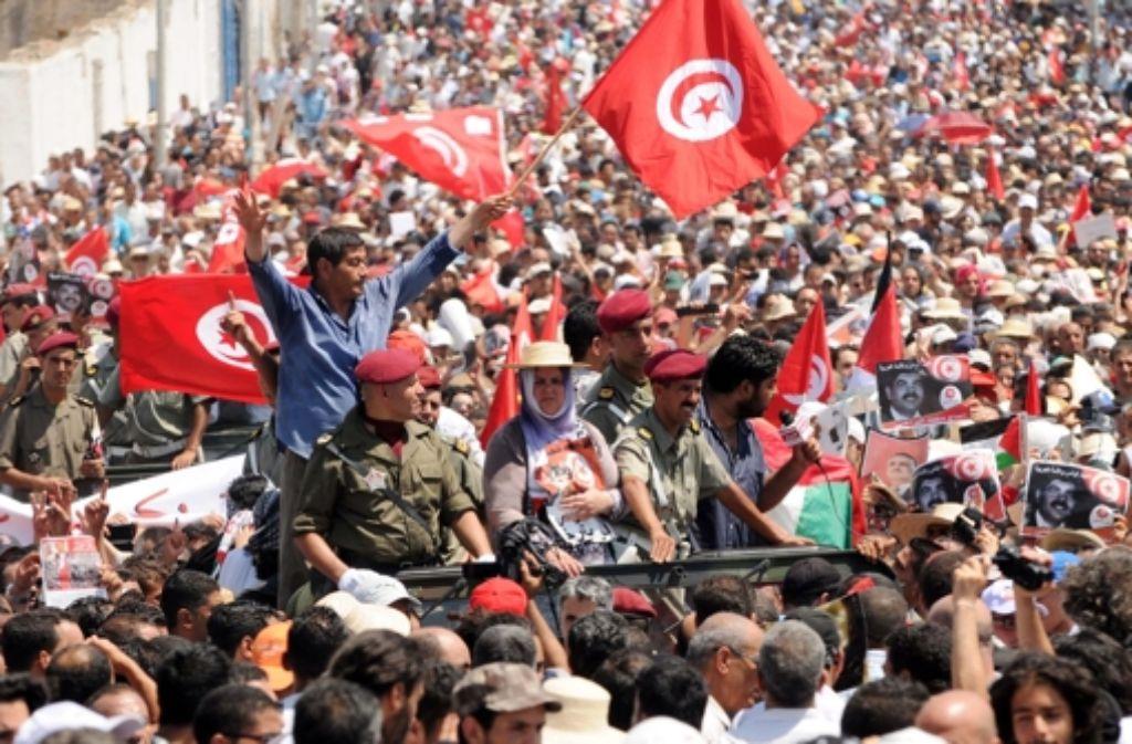 Protest auch nach  dem Arabischen Frühling: Eine Demonstration der Opposition in Tunis im Juli 2013. Foto: dpa