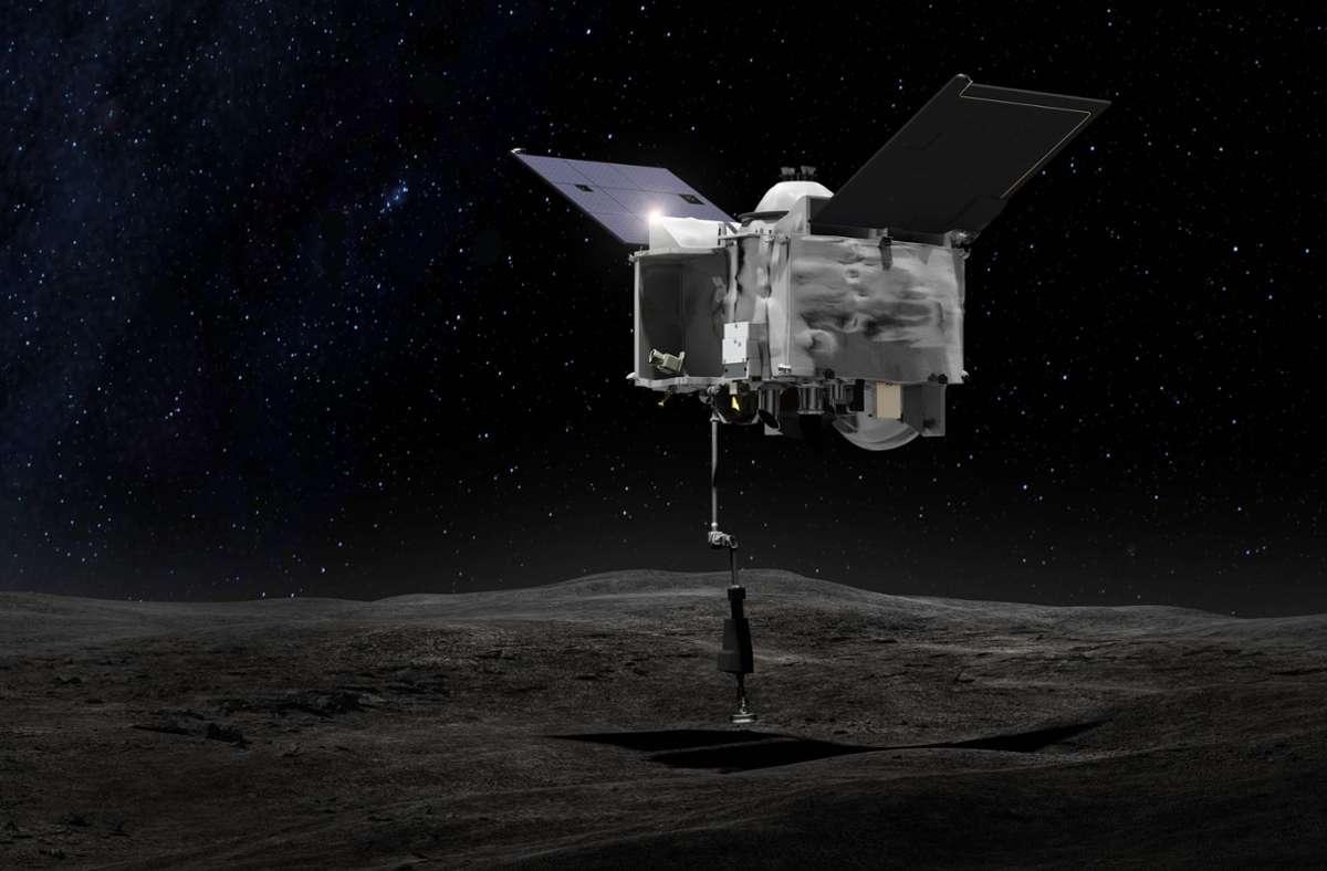 """Diese  grafische Darstellung zeigt die Nasa-Sonde """"Osiris-Rex"""", die über dem Asteroiden Bennu mit ihrem """"Touch-And-Go Sample Arm Mechanism"""", einer Art Roboter-Arm, eine Probe von dem Asteroiden nimmt. Foto: Nasa/Goddard Space Flight Center/dpa"""