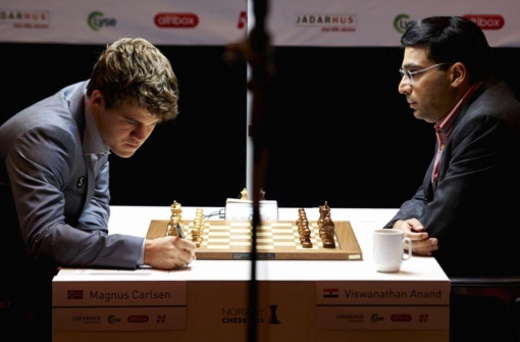 Schachmeister: Magnus Carlsen (links) und Viswanathan Anand Foto: AFP