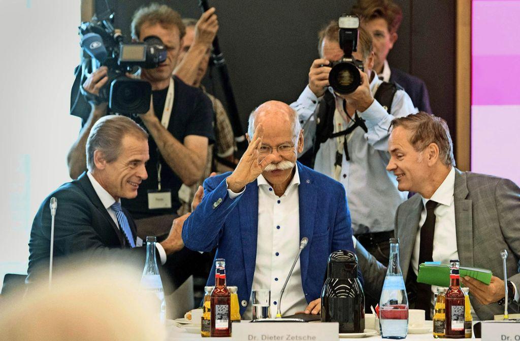 Volkmar Denner, Dieter Zetsche und Oliver Blume, die Chefs von Bosch, Daimler und Porsche(von links) wollenden Weg in die automobile Zukunft weisen. Foto: dpa