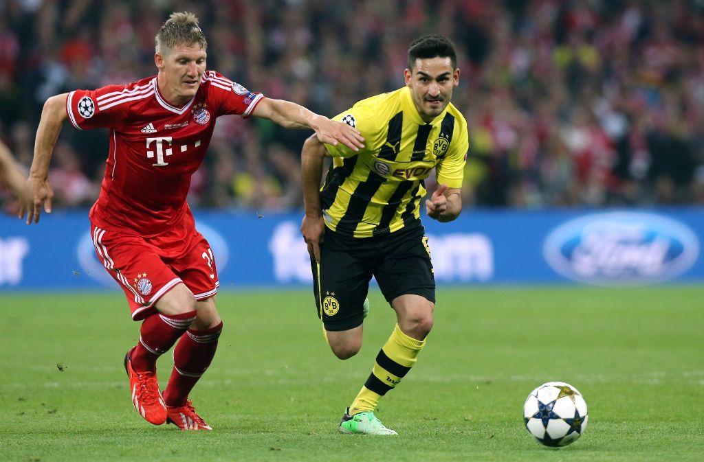 Das Duell FC Bayern gegen BVB: Bastian Schweinsteiger (li.) im Champions-League-Finale 2013 gegen Ilkay Gündogan von Borussia Dortmund. Foto: Baumann