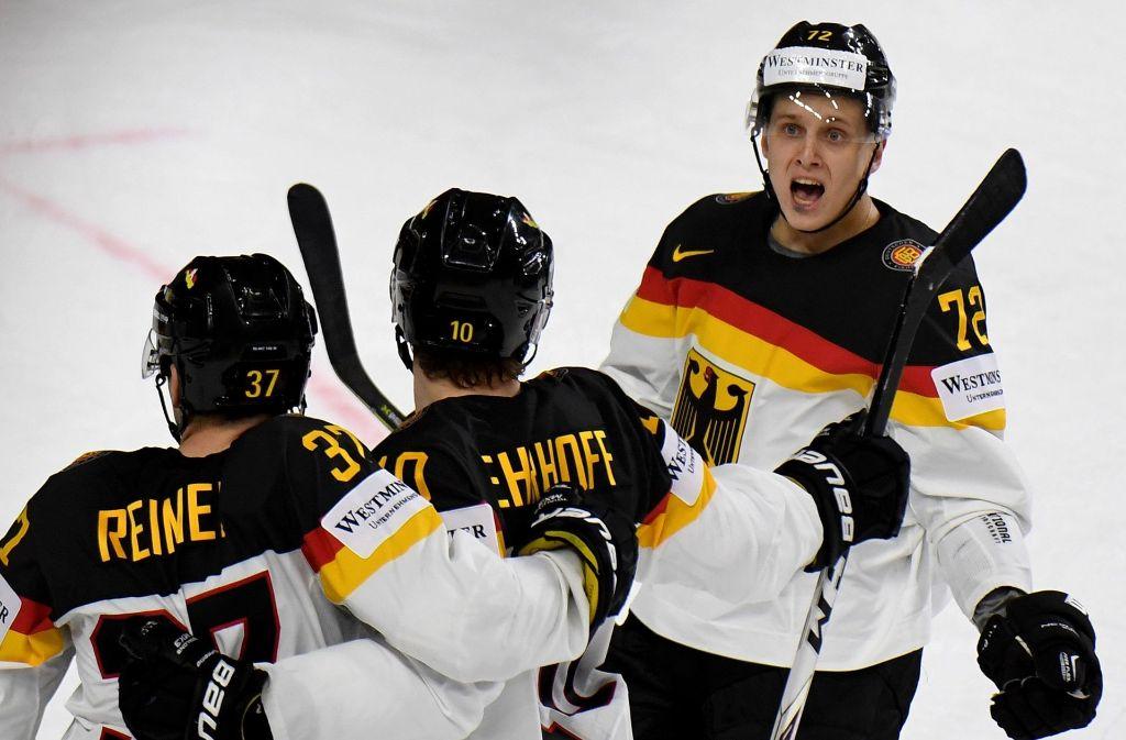 Großer Jubel bei der deutschen Eishockey-Nationalmannschaft Foto: dpa