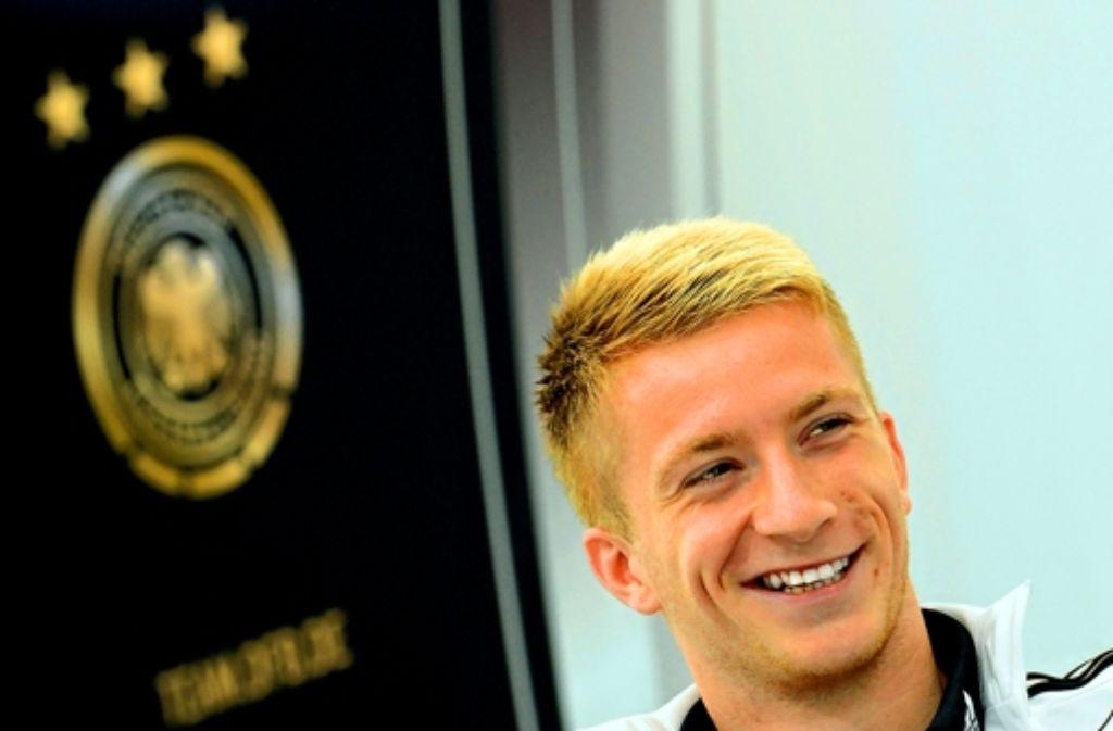 Haare schön? Marco Reus mit blondem Borstenschopf Foto: dpa
