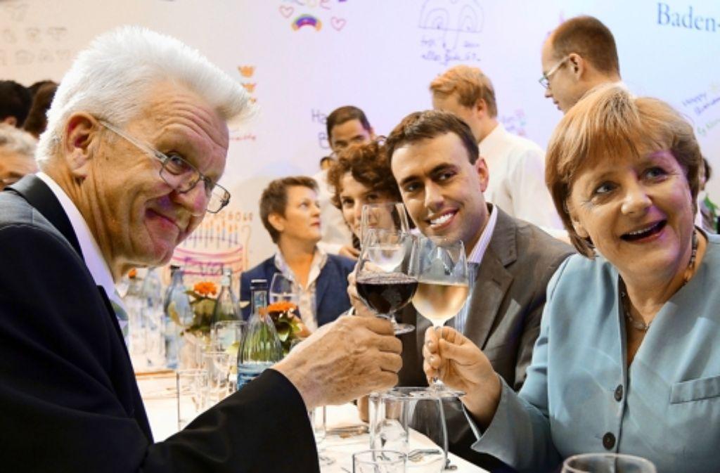 Winfried Kretschmann sagt, er habe  mit Kanzlerin Angela Merkel Foto: dpa
