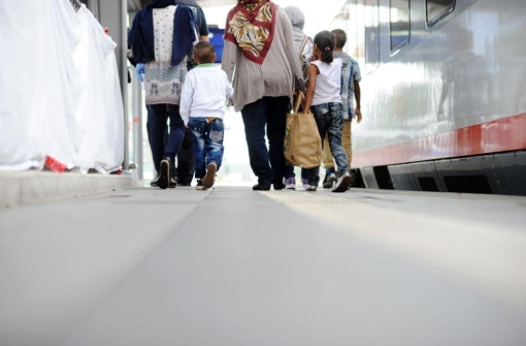 Täglich kommen neue Flüchtlinge in Rosenheim an Foto: dpa