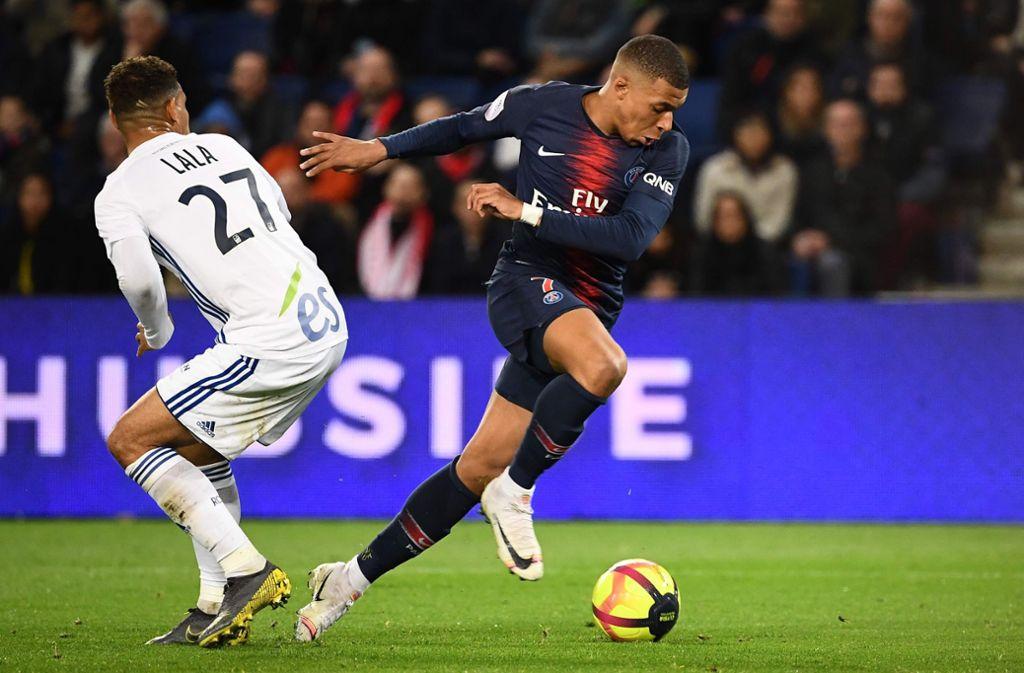 Kylian Mbappé (re.) zählt zu den besten Offensivspielern der Welt. Foto: AFP/Anne-Christine Poujoulat