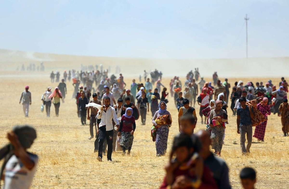 Im August 2014 wurden Tausende Jesiden von den kurdischen Volksverteidigungseinheiten (YPG) aus dem Sindschar-Tal befreit. Foto: picture alliance / AA