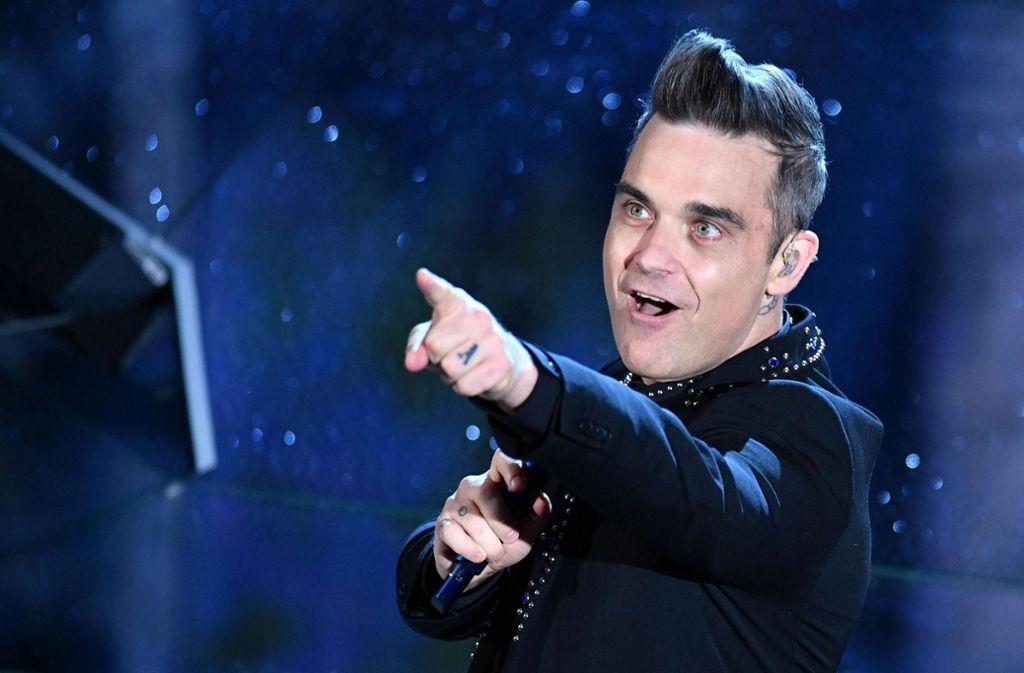 Ein bisschen grauer ist er geworden und fülliger auch, aber Robbie Williams ist immer noch ein begnadeter Entertainer. Foto: dpa