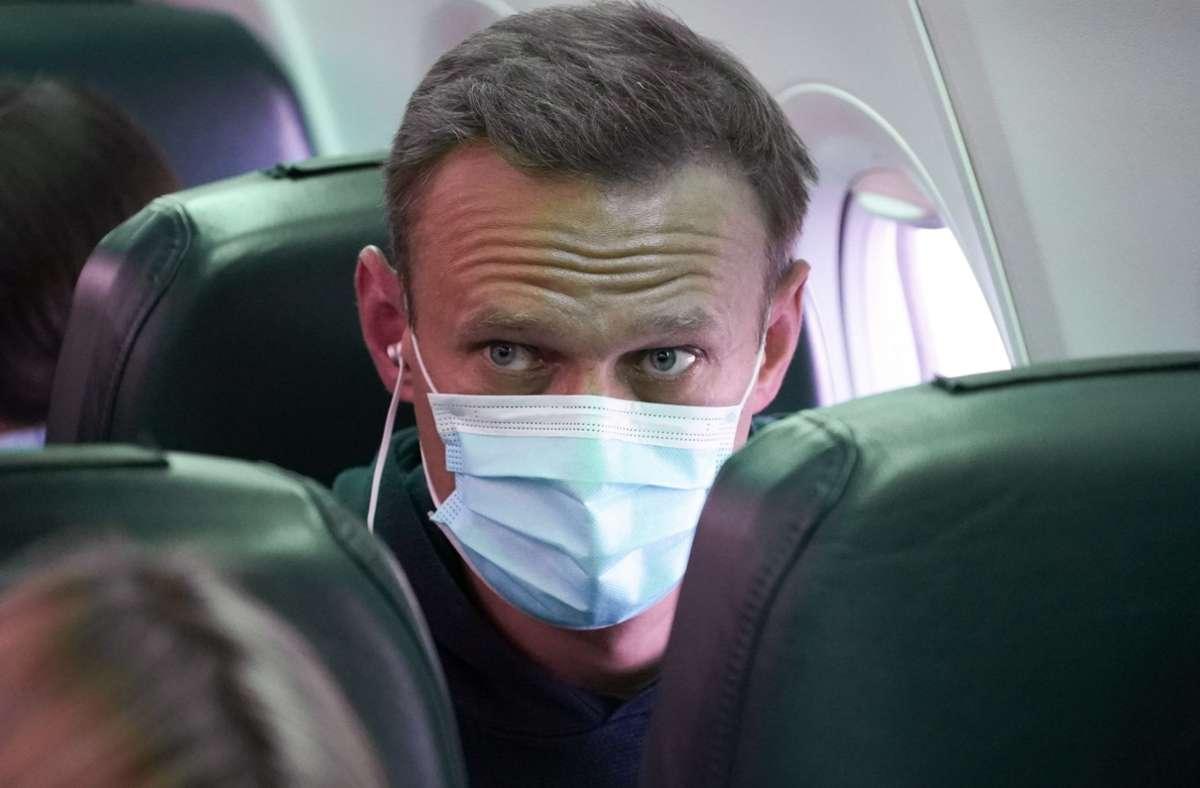 Kremlgegner Alexej Nawalny während seines Flugs nach Moskau. Foto: dpa/Mstyslav Chernov
