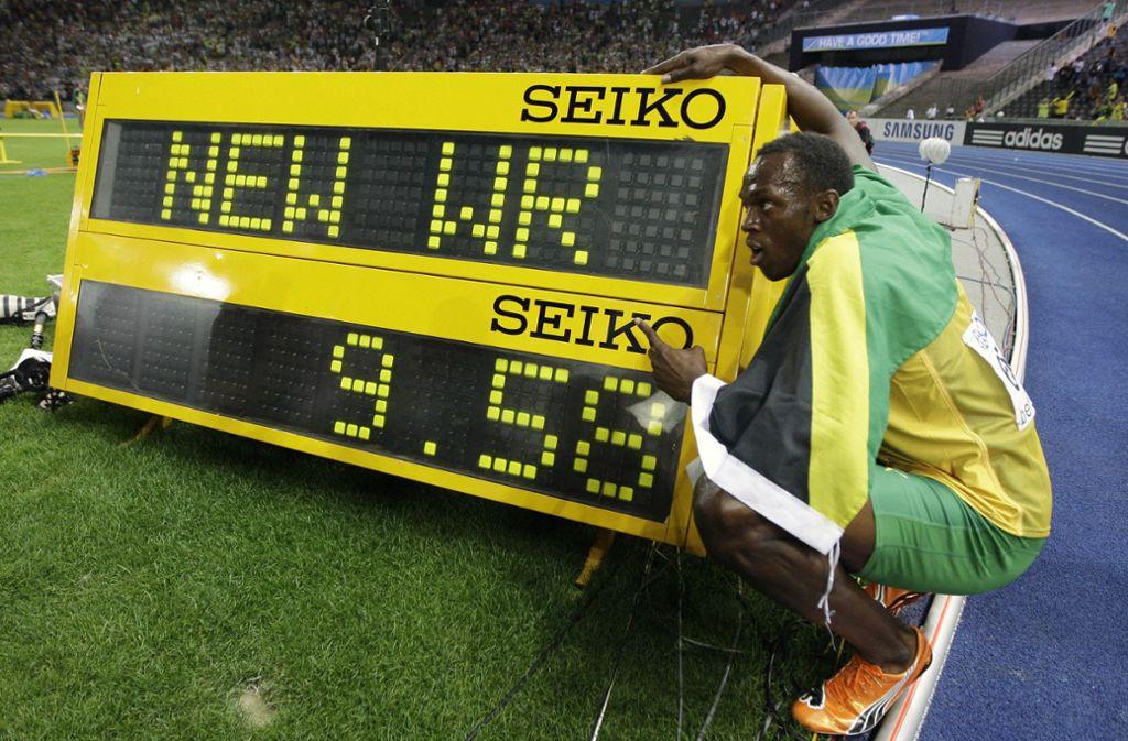 Usain Bolt und die Zahl seines Lebens. Foto: AP