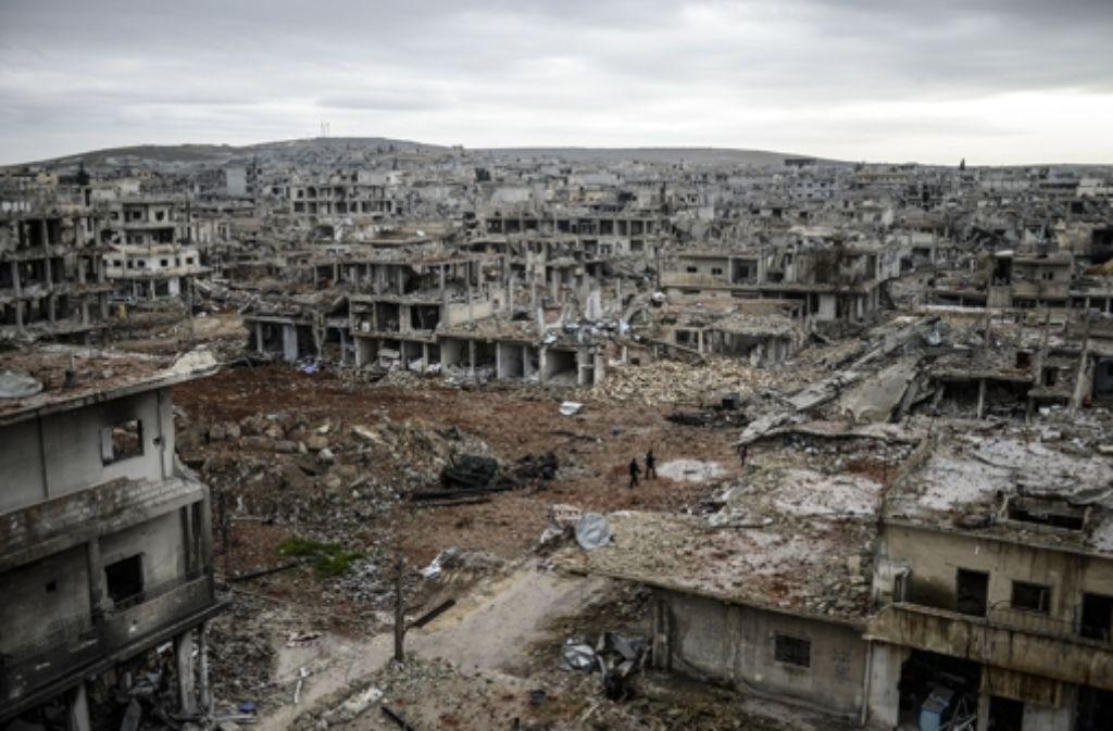 Die verbliebenen Bewohner von Kobane führen ein Leben in Trümmern. Foto: AFP