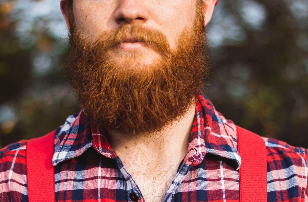 Männlich, so ein Bart – aber das Coronavirus ist kein Männerschnupfen. (Symbolbild) Foto: Unsplash/Photo by Abby Savage