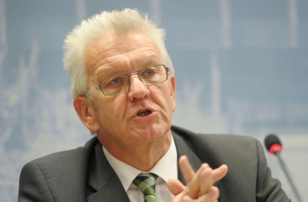 Ministerpräsident Winfried Kretschmann zeigt sich gesprächsbereit, wenn es um die Flughafentrasse geht. Foto: dpa