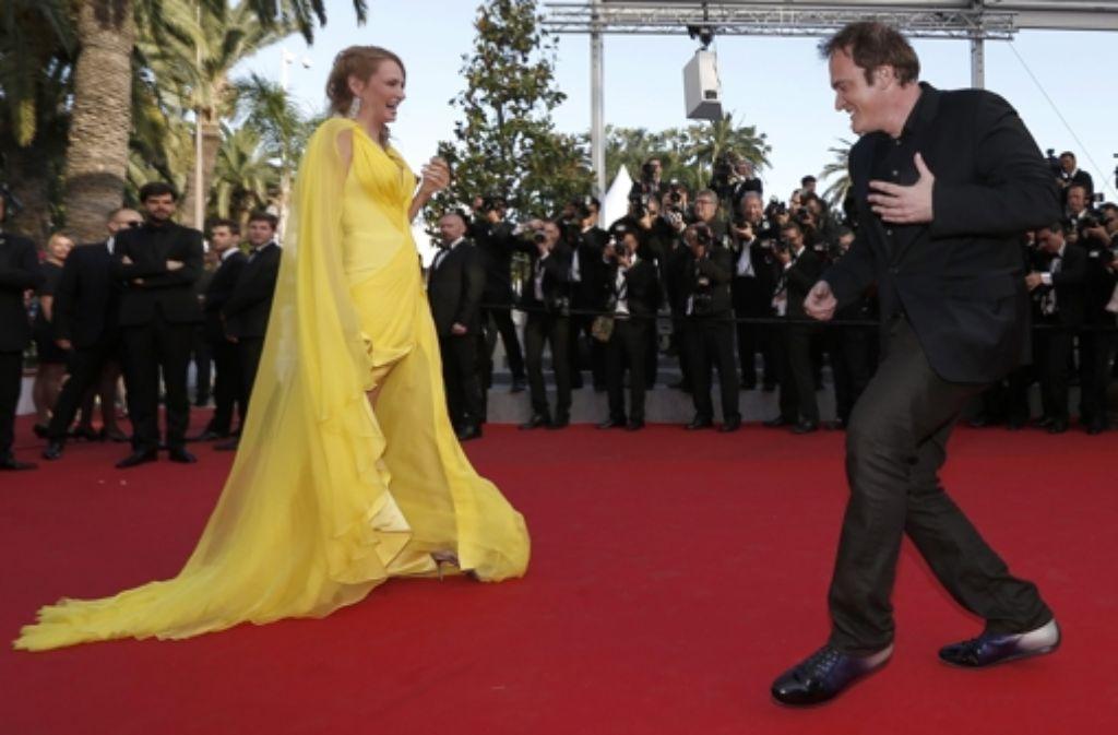 Quentin Tarantino und Uma Thurman haben sichtlich Spaß auf dem Roten Teppich bei den Filmfestpspielen in Cannes. Sie besuchten die Premiere des Films Clouds of Sils Maria, der sich in diesem Jahr im Rennen um die Goldene Palme befindet. Foto: dpa