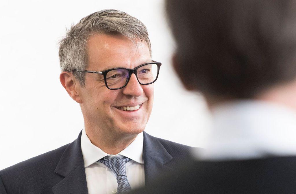 Der Insolvenzverwalter Arndt Geiwitz am Montag beim Bankrott-Prozess im Stuttgarter Landgericht. Foto: AFP