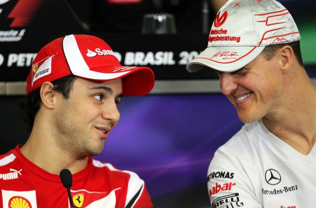 Michael Schumacher (rechts) und Felipe Massa fuhren 2005 und 2006 gemeinsam bei Ferrari. Foto: EFE