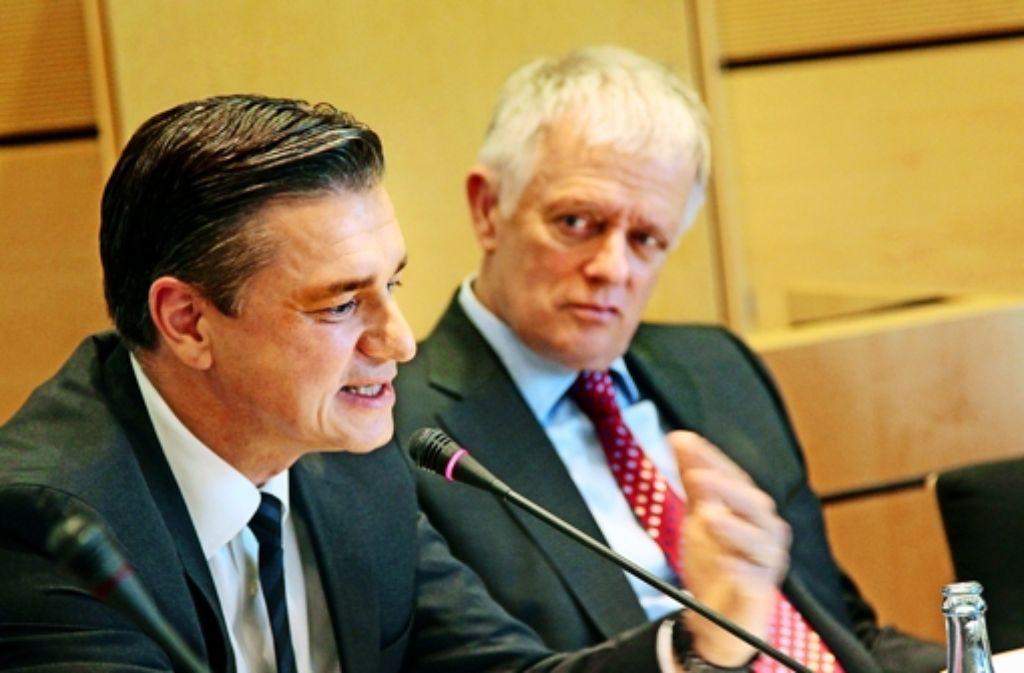 Porsche-Finanzchef Meschke und OB Kuhn können zufrieden sein. Foto: FACTUM-WEISE