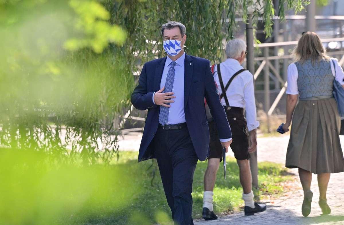Das Land verschärfe zudem seine Auflagen für eine Maskenpflicht. Foto: dpa/Peter Kneffel