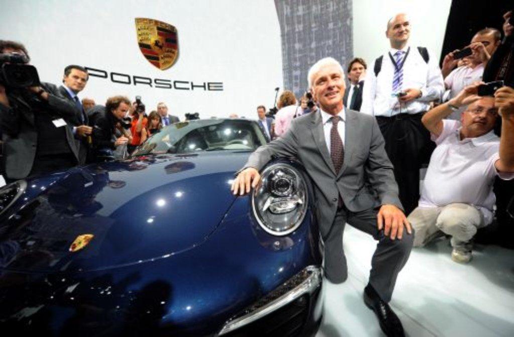 Porsche-Chef Matthias Müller denkt nicht vorrangig an die Verschmelzung mit VW. Foto: dpa