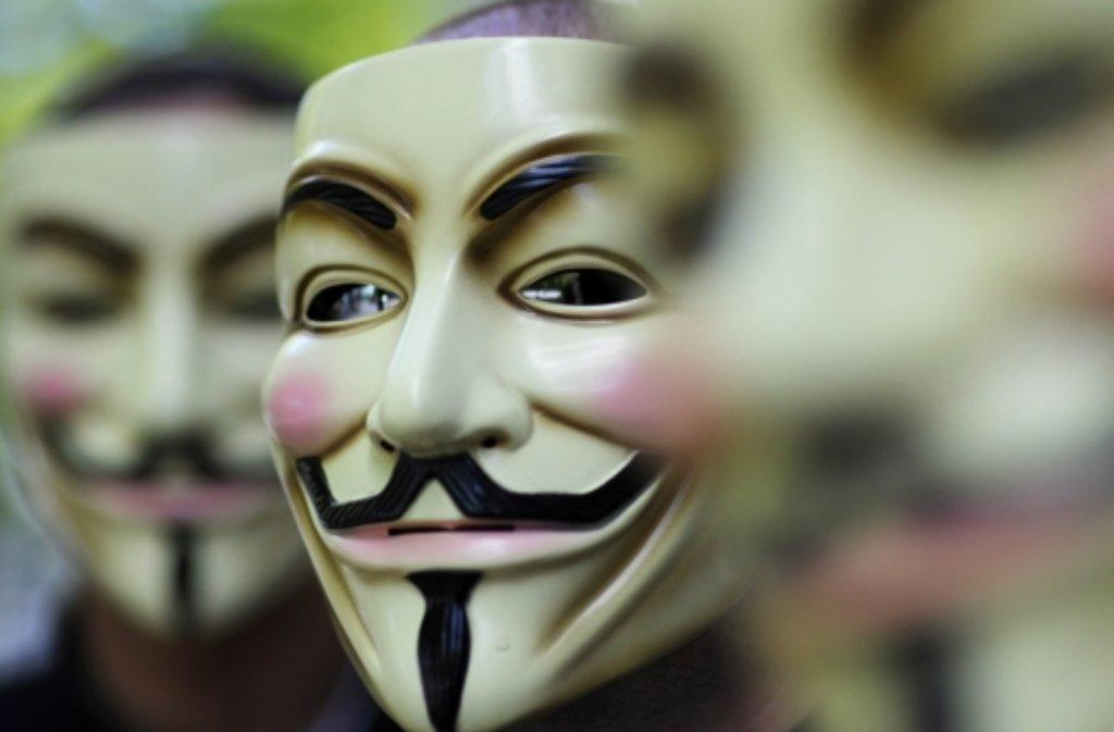Due Guy-Fawkes-Masken sind popkulturelles Symbol von Anonymous. Foto: dapd