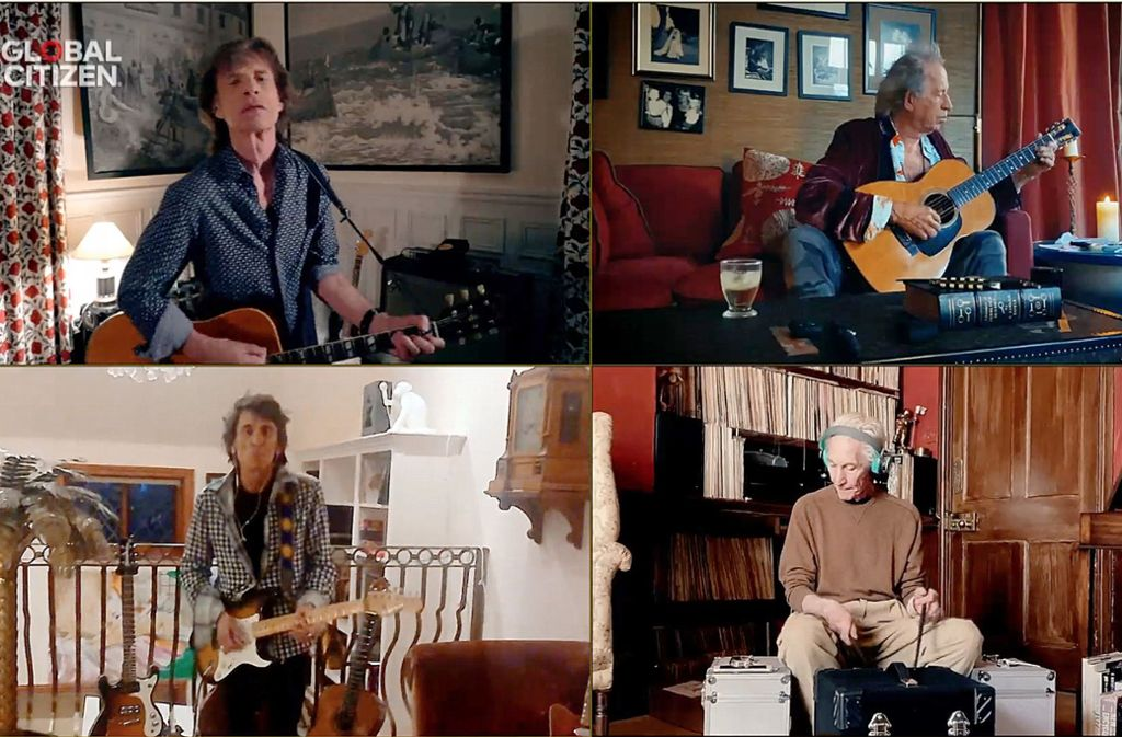 "Mick Jagger, Keith Richards, Charlie Watts und Ron Wood spielen getrennt und doch gemeinsam ""You Can't Always Get What You Want"". Foto: dpa/Olivier Douliery"