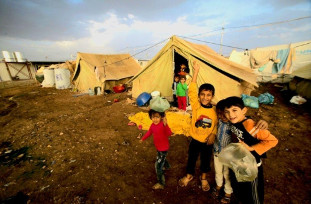 Eine Heimat auf Zeit im Nordirak: vor den  Kämpfen in Syrien sind viele Familien mit ihren Kindern  geflohen- Foto: AFP