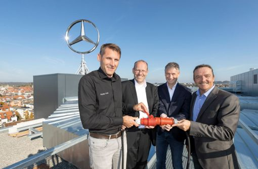 Der Mercedes-Stern strahlt wieder über der Stadt