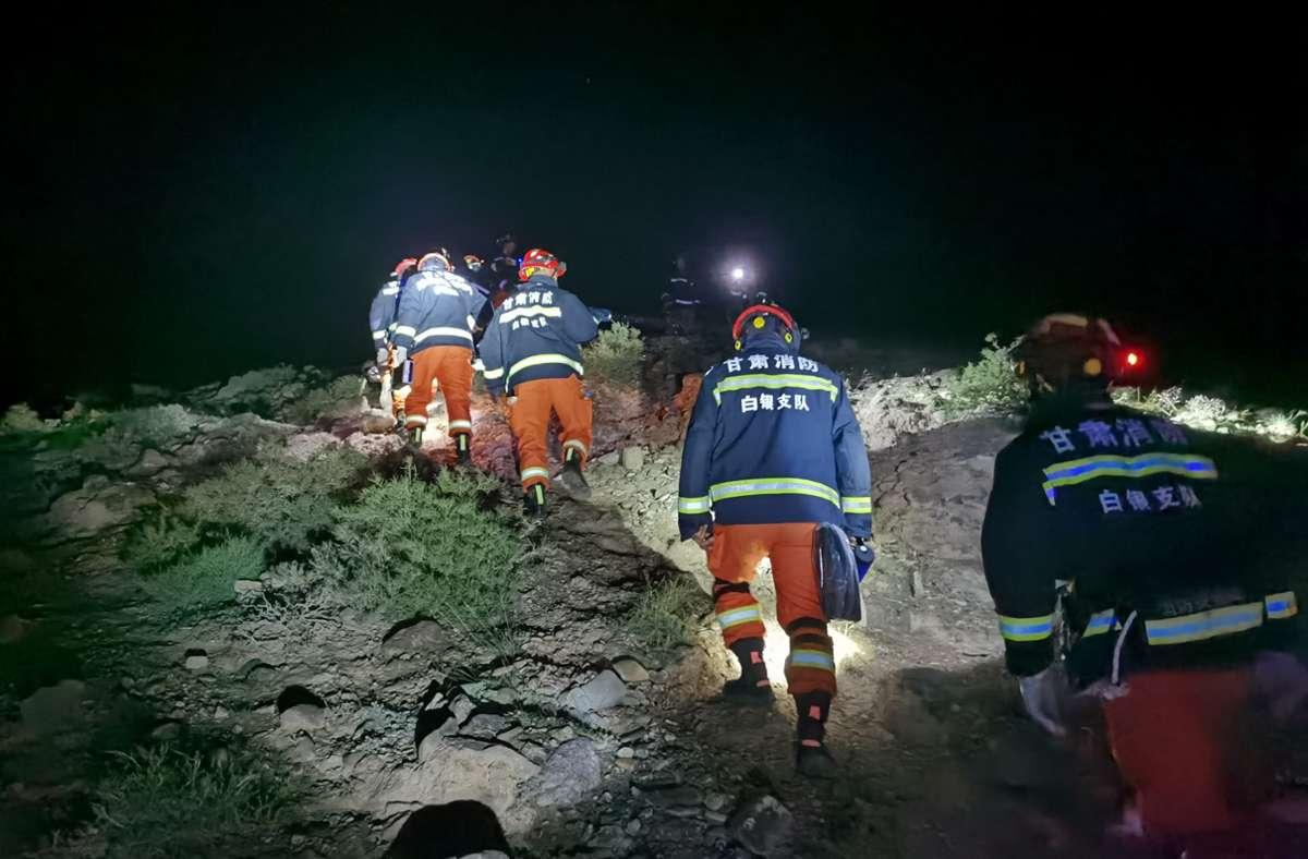 Zahlreiche Helfer suchten nach den Vermissten. Foto: dpa