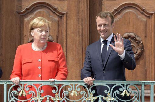 Merkel und Macron wollen beim Asylkonflikt an einem Strang ziehen