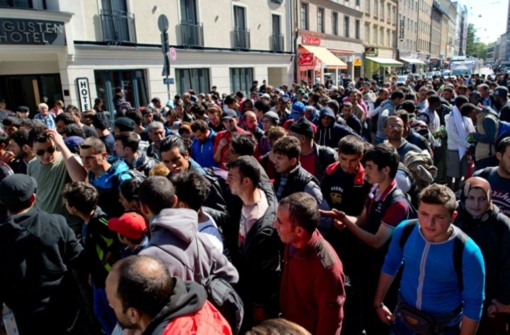 In München kommen immer mehr Flüchtlinge an, Die Stadt sieht sich mittlerweile am Limit. Foto: dpa