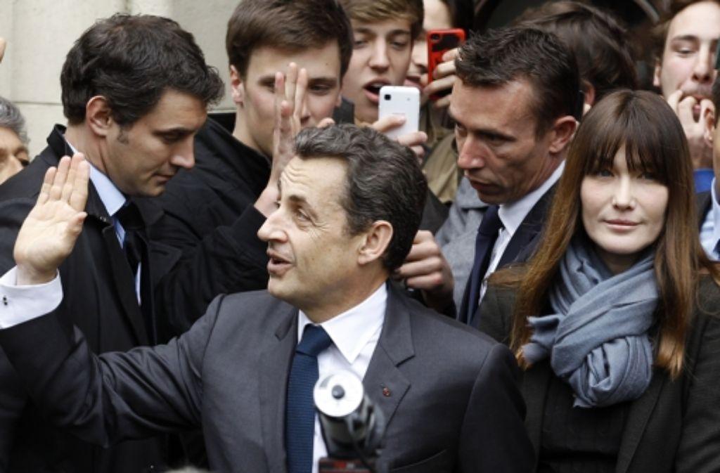 An der Seite ihres Gatten war Carla Bruni stets ins Protokoll des Elysée-Palasts eingezwängt. Diese Zeiten sind nach der Abwahl von Nikolas Sarkozy vorbei. Foto: dapd