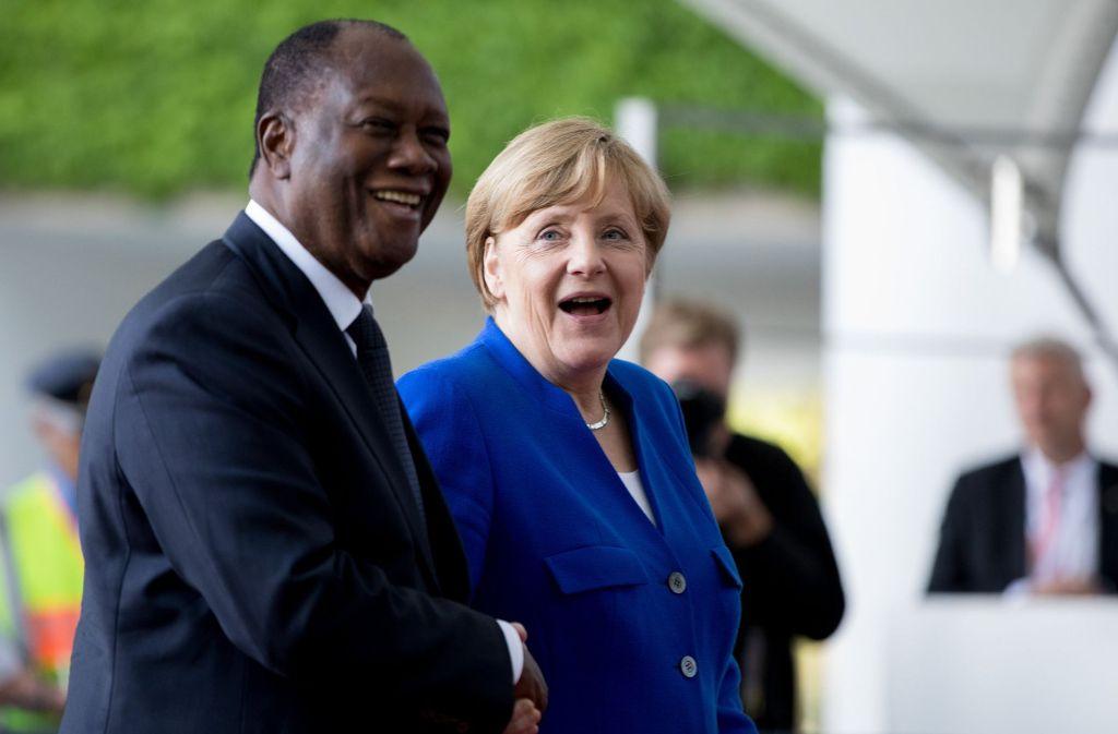 Die Elfenbeinküste unter Präsident  Alassane Ouattara gehört zu den wenigen Ländern, die sich auf eine von Kanzlerin Angela Merkel vorangetriebenen Reformpartnerschaften mit Deutschland eingelassen hat. Foto: dpa