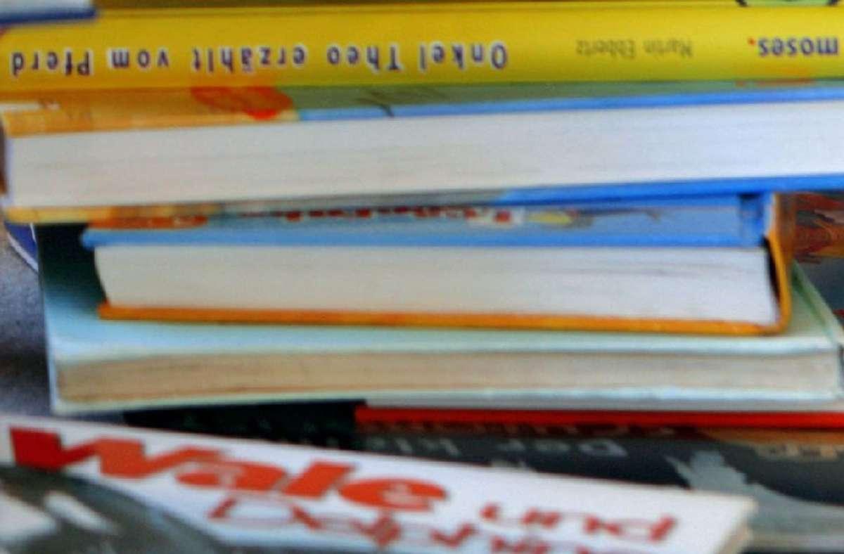 25 Bilderbücher haben Einbrecher in einer Kita in Nordrhein-Westfalen gestohlen (Symbolfoto). Foto: dpa/dpa