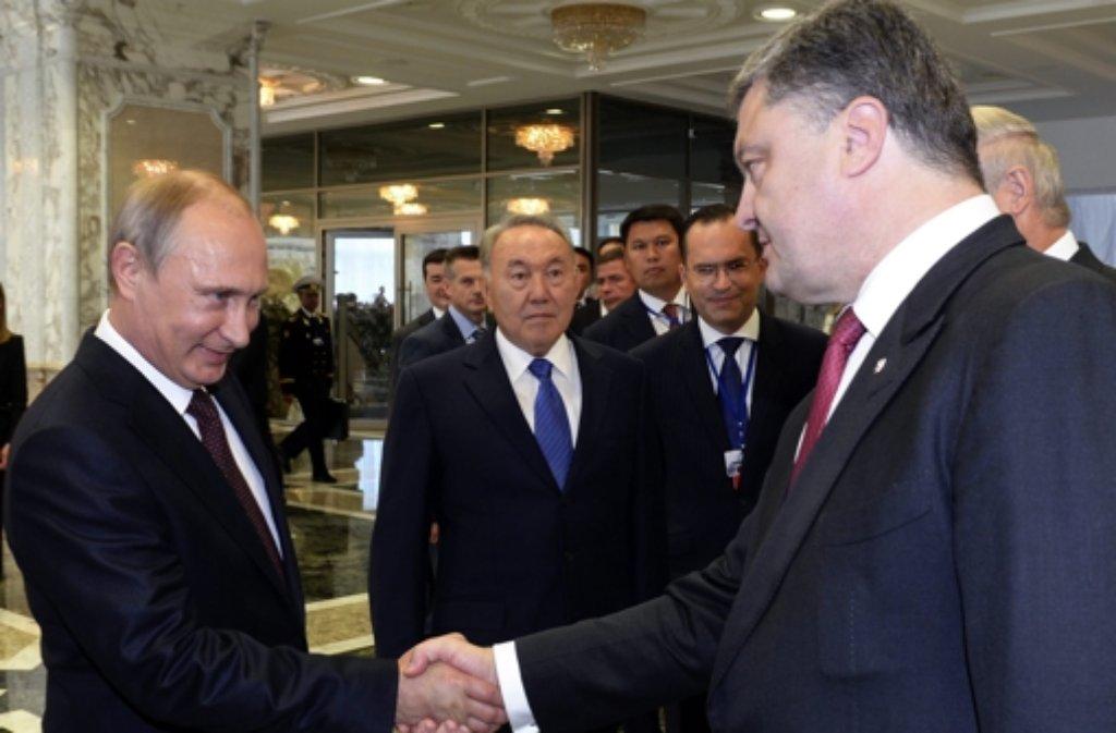 Wladimir Putin und Petro Poroschenko treffen sich in Minsk. Foto: dpa