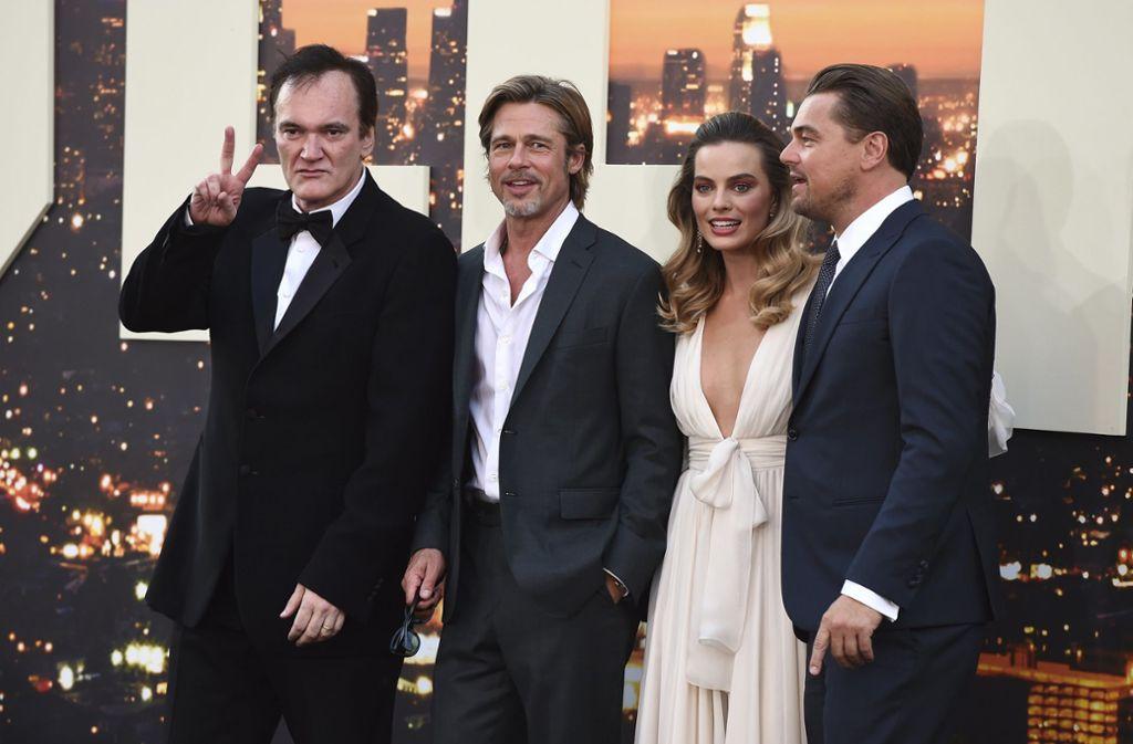 Quentin Tarantino zusammen mit seinen Hauptdarstellern Brad Pitt, Margot Robbie und Leonardo DiCaprio (v.l.) Foto: AP