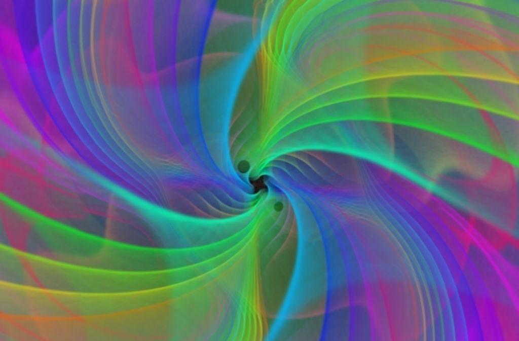 Numerische Simulationen visualisieren, wie zwei Schwarze Löcher verschmelzen - unter Abstrahlung von Gravitationswellen. Foto: dpa