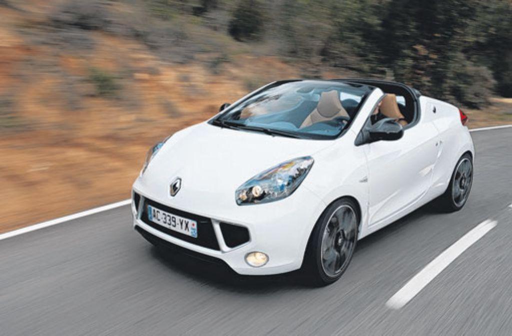 Optisch fällt der Renailt Wind allemal auf. Das kleine Klappdach macht ihn eher zum Targa als zum Cabriolet. Foto:  Renault